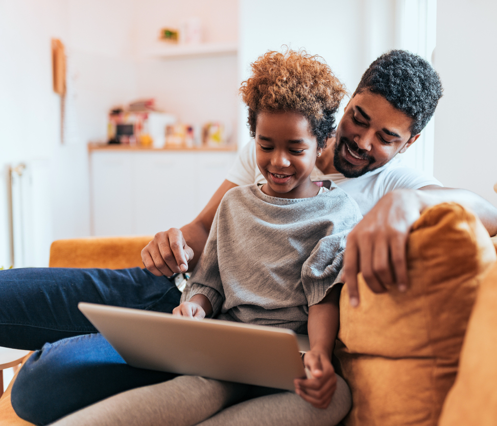 Dad and daughter having online therapy session at home