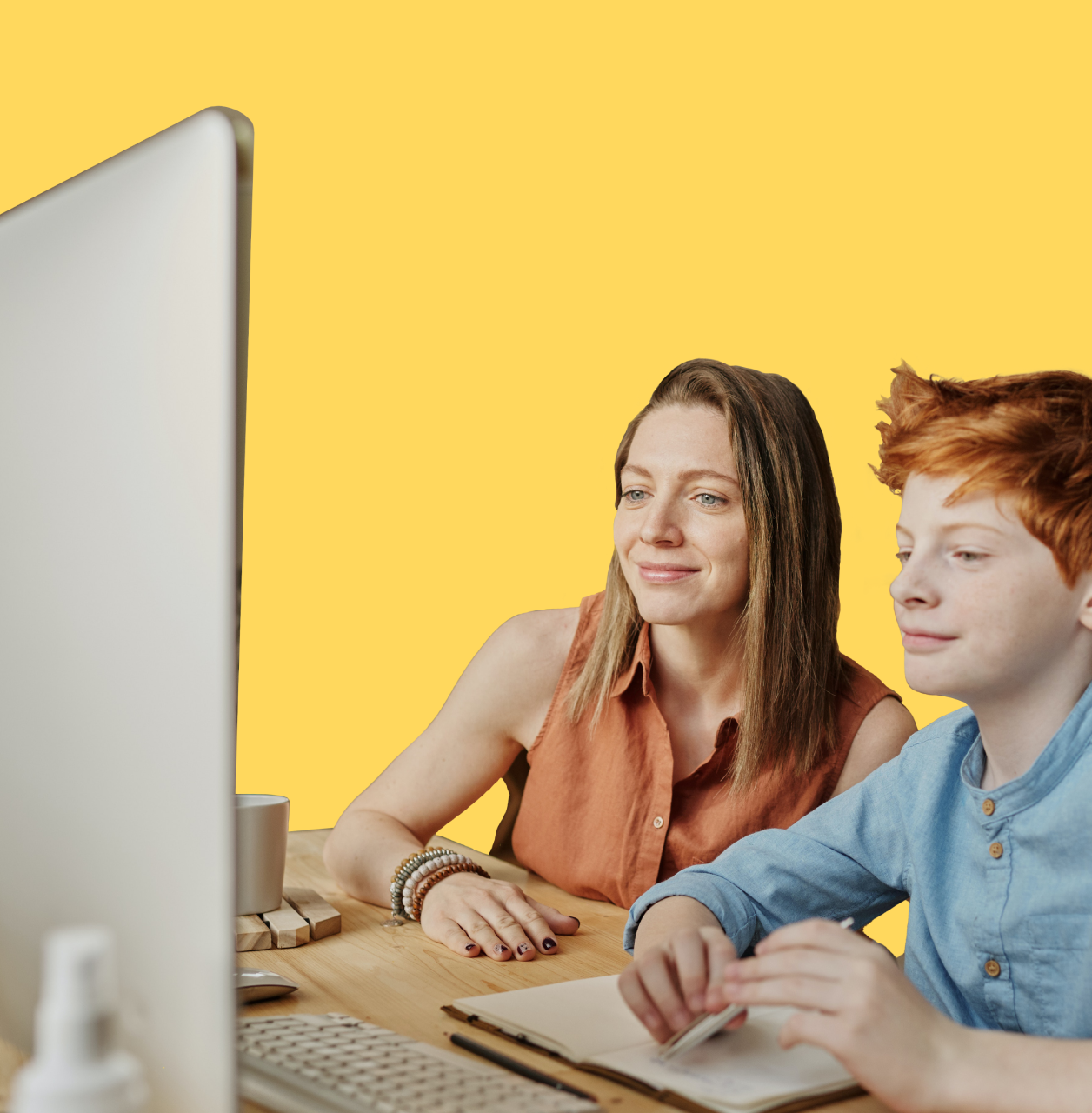 Boy and woman using laptop